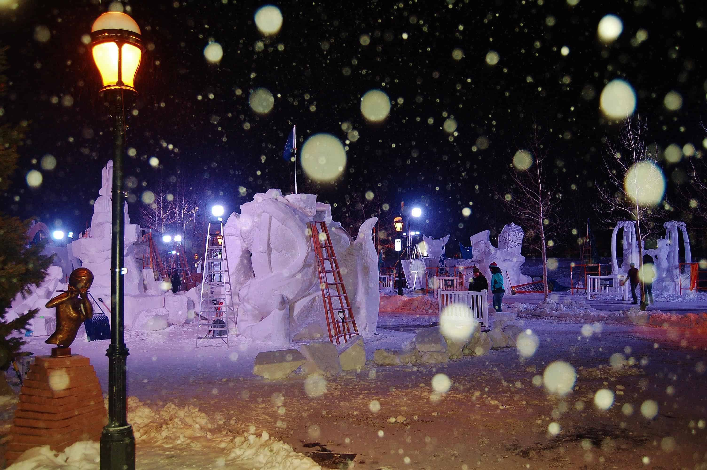 The Friday before the close of sculpting, teams work through the night to complete their masterpieces, each constructed from a 12-foot-tall, 20-ton block of Colorado snow.